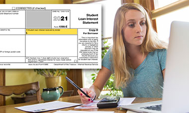 Woman doing taxes at her computer, using 2020 Form 1098-E.